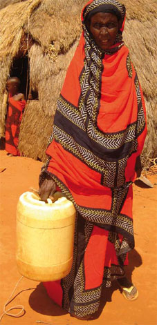 African woman struggles with water